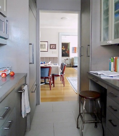 Gray-stained kitchen cabinets looking back towards the living room