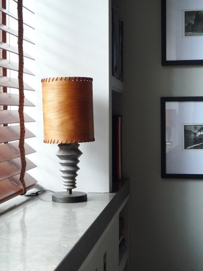 Hand-crafted accent lamps set off the Lagos Azul stone window sill