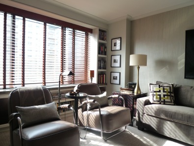 Motorized wood blinds surrounded by custom surround and cabinetry