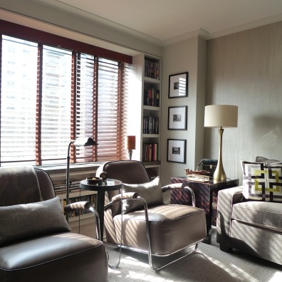 Motorized wood blinds offer total light control with a programmed remote.