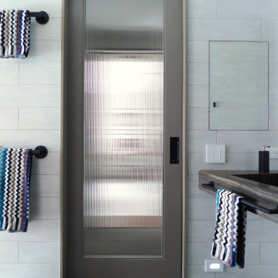 Ribbed glass pocket door to the dressing room.