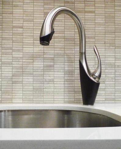 Graceful kitchen faucet with mosaic splash tiles