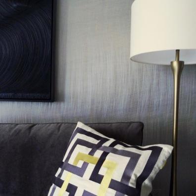 Gilt accent wall, velvet sleeper sofa, James Austin Murray painting.