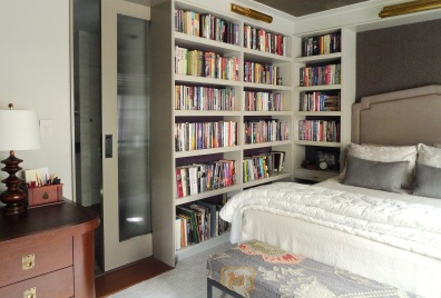 A glass pocket door tucks behind the bookcase