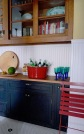 Beadboard and a wood counter are used in the pantry area of the kitchen.