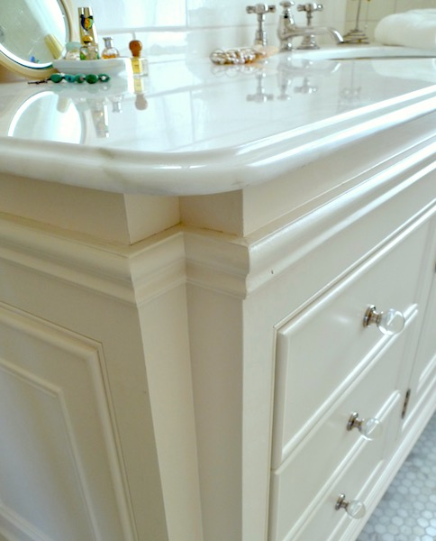 Ogee counter edge and molding details on vanity