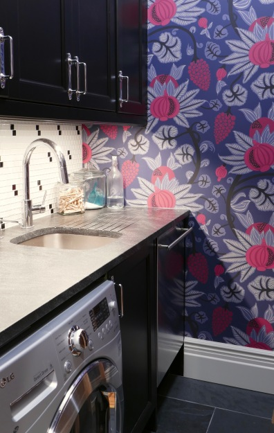 The old kitchen becomes a laundry room with a second sink and fun wallpaper