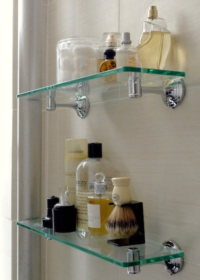 Glass shelves hold shaving supplies