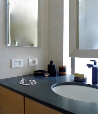 The sink was moved to run in front of the window, which is frosted glass.
