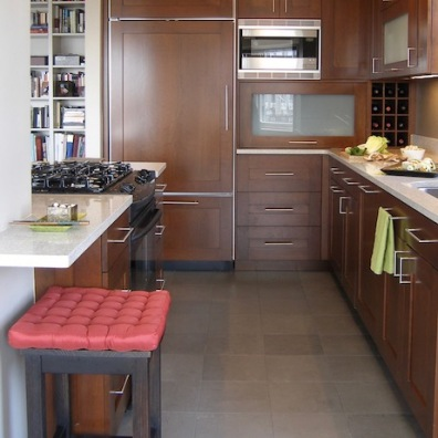 A *tall wall* at the end of the kitchen incorporates a paneled fridge, microwave, appliance garage and wine rack.