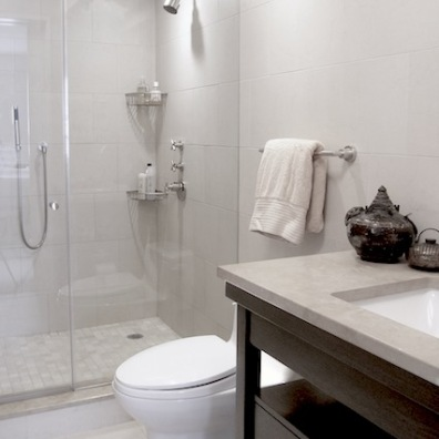 Oversized porcelain wall tiles with custom washstand and stone top
