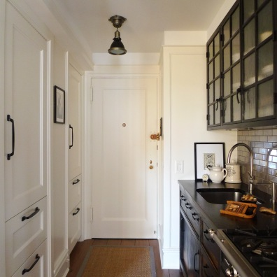 The kitchen with concealed fridge and pantry