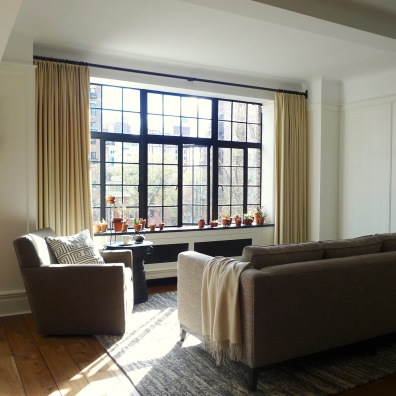 After: Board-and-batten wainscoting unifies the the living space
