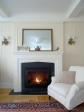The chimney and fireplace in this creamy room are faux – new additions made to look original.