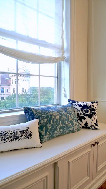 When you want just a hint of a window treatment, try unlined sheer linen roman shades.