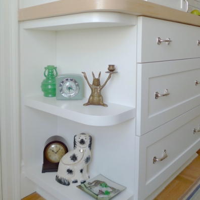A curved open base is a good transition at the end of cabinet runs in a high-traffic area.