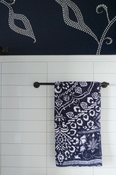 Paisley towels play off the wall pattern