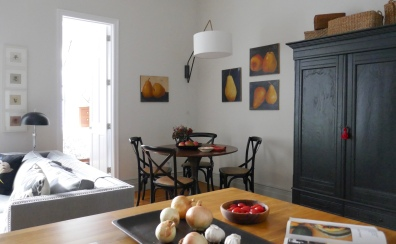 A wall-mounted light over the table is a great solution without re-wiring