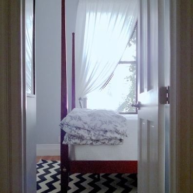 The bedroom picks up the black accents