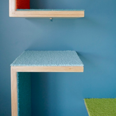 Detail, cat tower fashioned from baltic birch and colorful carpet tiles.