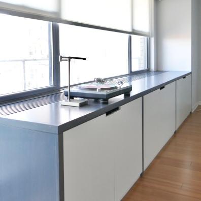 Custom cabinetry holds all AV equipment as well as the HVAC.